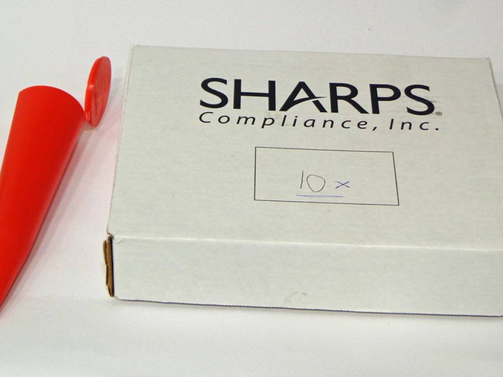 Safety \'sharps\' containers. 10 x red, cone shaped safety containers.